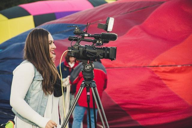 woman camera media
